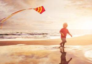 boy-with-kite-on-beach