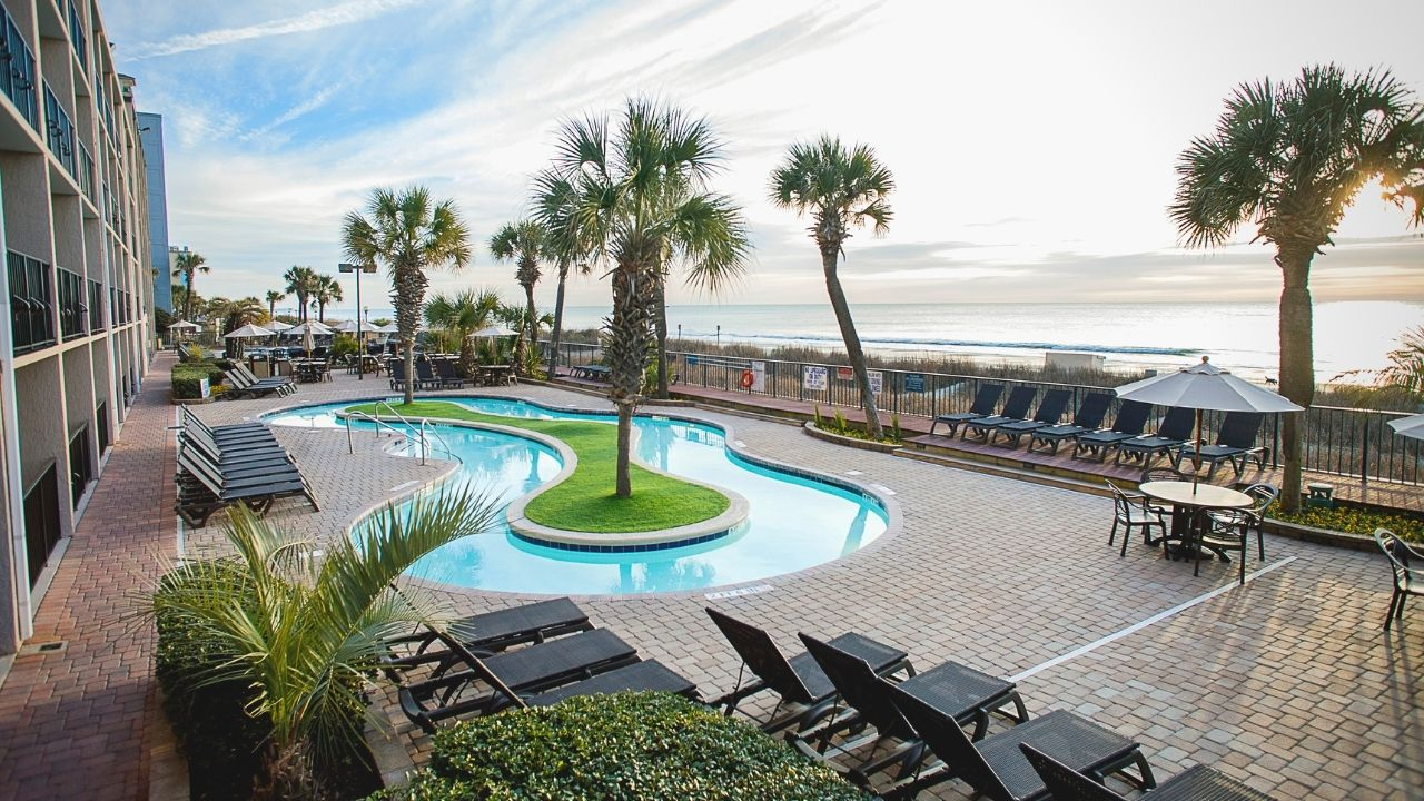 Oceanfront pool deck at Compass Cove