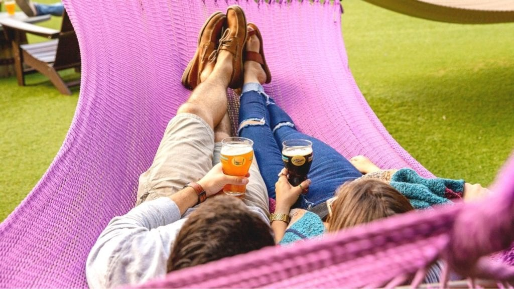 Couple on Hammock with Beers