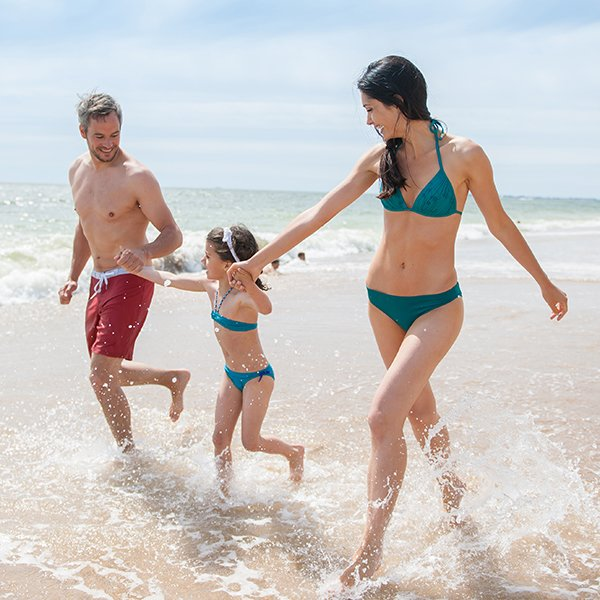 Family On Beach Together