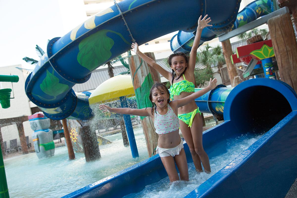 Kids Playing On Water Slide At Ocean Reef